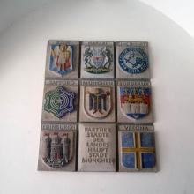 Гербы городов-побратимов Мюнхена